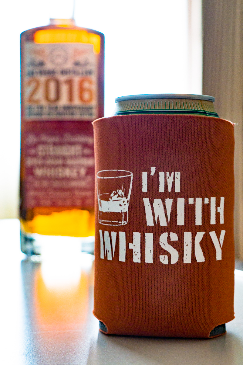 """I'm With Whisky"" Sidekick Sleeve. Show off what you really love while you sip a lesser beverage! Keep your drink cool and your hand dry with this scuba foam collapsable can holder. Holds most cans and single-serving bottles."